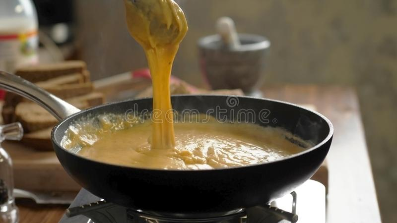 Croutons with garlic in the kitchen. Cooking delicious croutons with garlic in the kitchen, breakfast, beer snack stock images