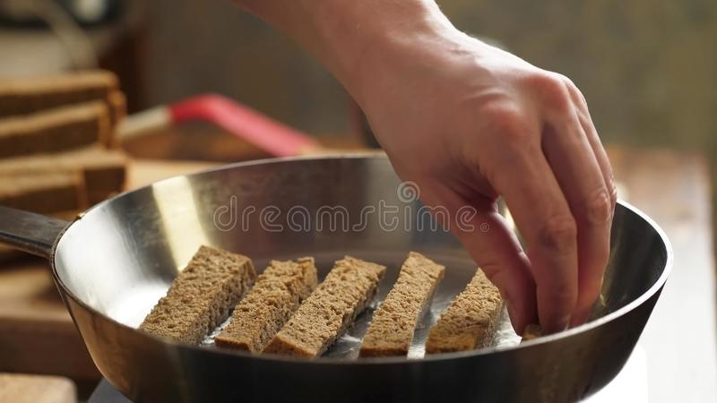 Croutons with garlic in the kitchen. Cooking delicious croutons with garlic in the kitchen, breakfast, beer snack stock image