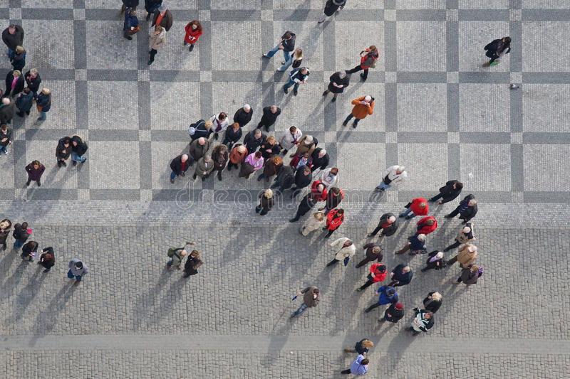 Crowd. Of people in center of town, top view royalty free stock photos