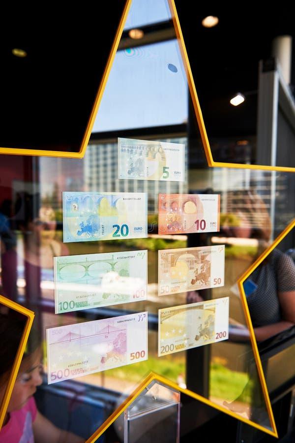 Crowd admiring all European Union Euro notes stock image