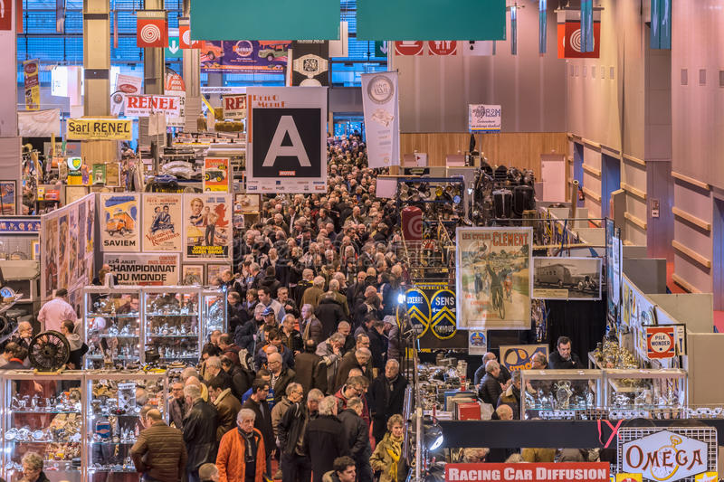 The crowd in the aisles of the Show. Big crowds at Retromobile Paris exhibition in 2017