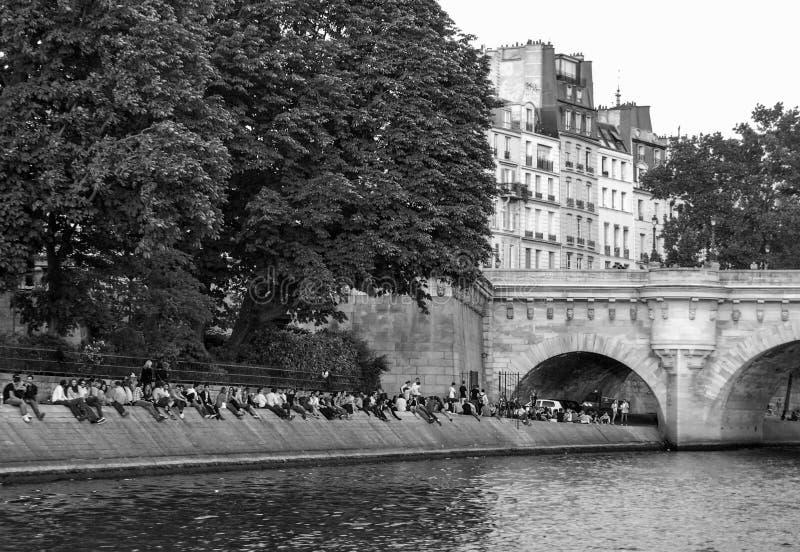 Crowd on Banks of River Seine Paris stock photo