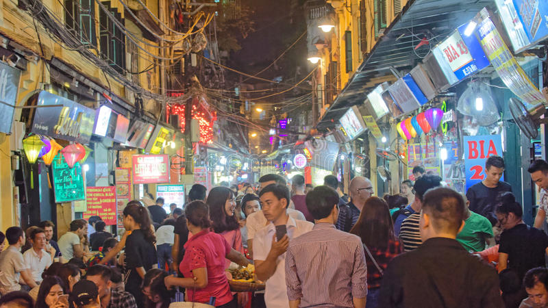 Crowd and Bia Hoi restaurants in Hanoi old city royalty free stock image
