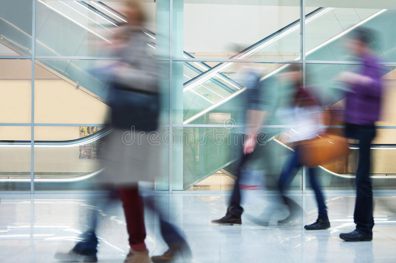 Crowd of Blurred Young People Walking Along Modern Corridor stock photography