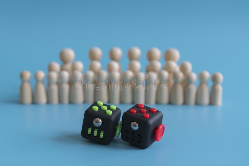 Crowd calm concept. answer how to calm the crowd. Cube stress reliever and wooden figures on a blue background.  stock photos