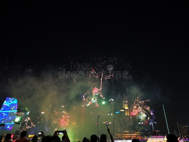 Silhouettes of people watching a fireworks display. Stock photo. stock photo