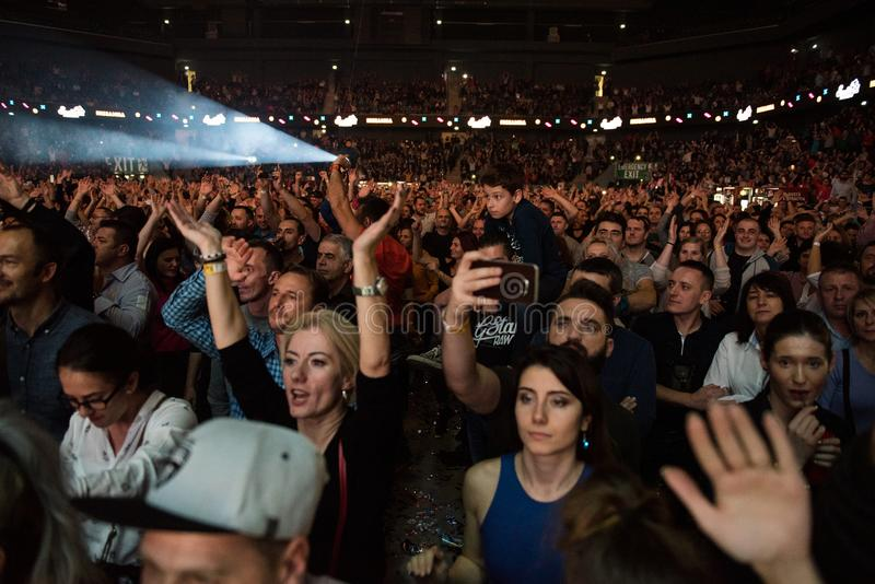 Crowd of cheerful people partying at a live concert. CLUJ NAPOCA, ROMANIA - NOVEMBER 19, 2017: Crowd of cheerful people dancing and partying during the We Love royalty free stock images