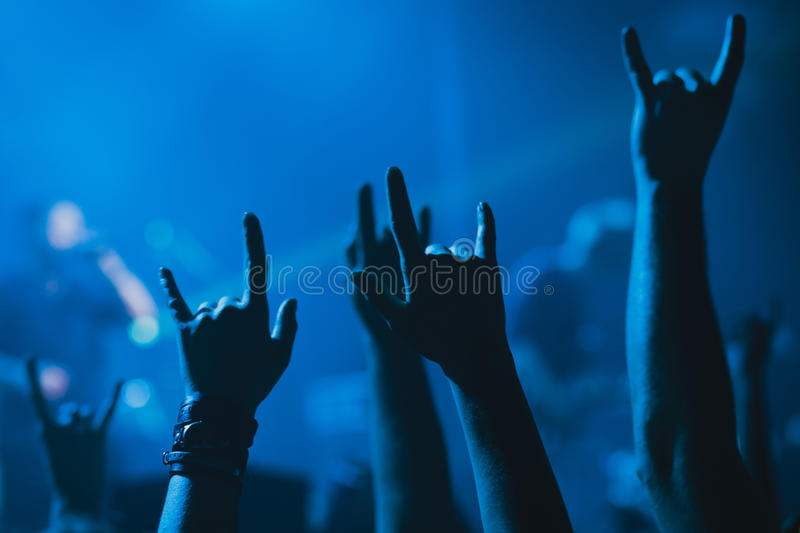 Crowd, cheering and watching a band on stage royalty free stock photos