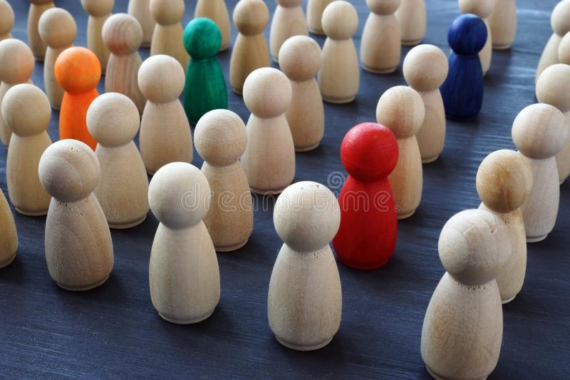Crowd of colored figures. Recruitment and talent search. Uniqueness and individuality. Concept royalty free stock photo