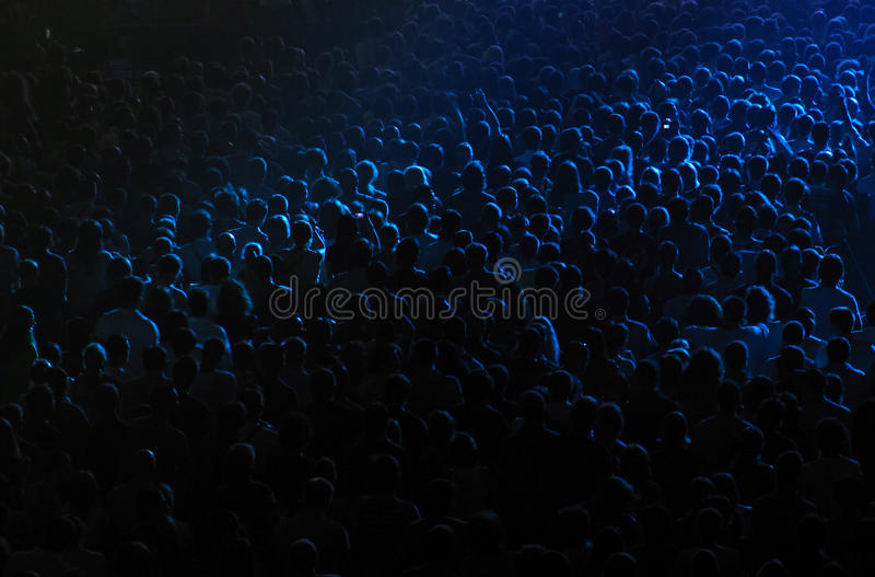 Crowd in a concert hall royalty free stock images