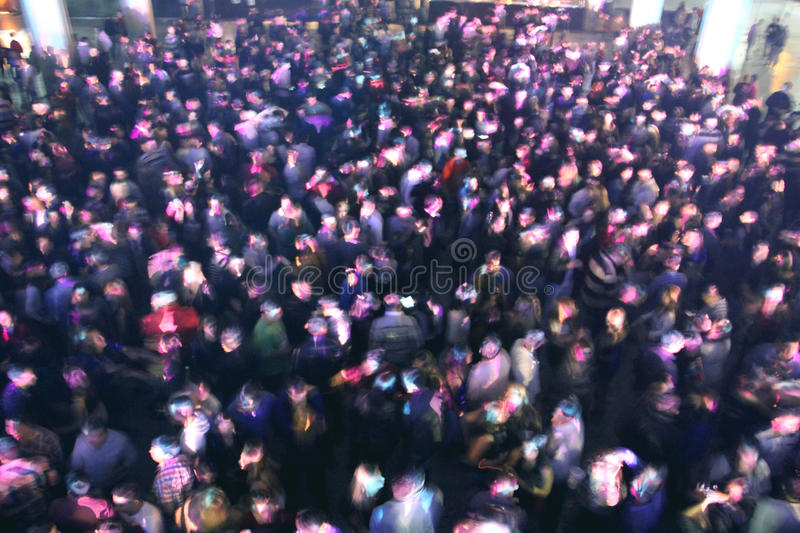 Crowd at concert or party. People at concert or show, all together, party having fun, happy, night, drinking with friends. Blue lights, dark environment, against royalty free stock photos