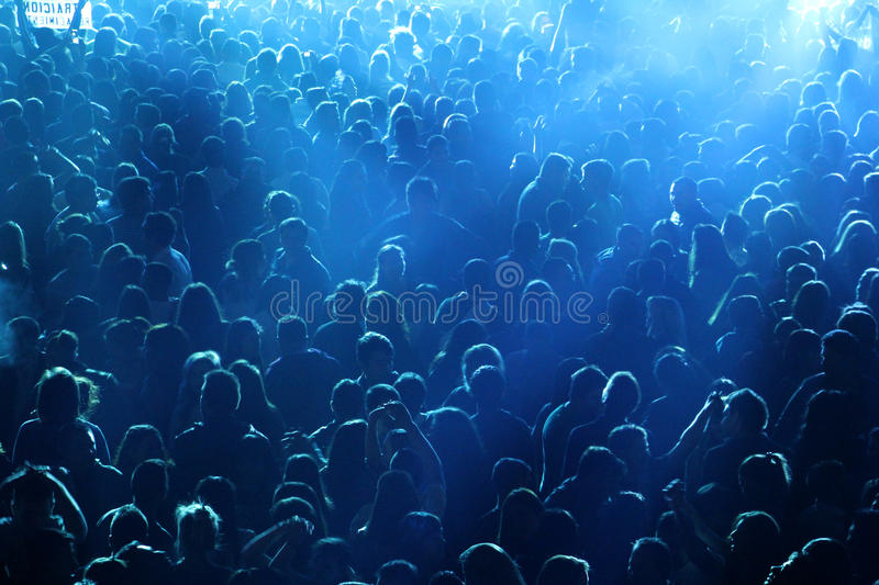 Crowd at concert or party. People at concert or show, all together, party having fun, happy, night, drinking with friends. Blue lights, dark environment, against stock photos
