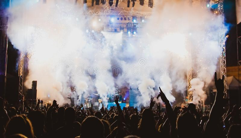 crowd at concert and stage lights with space for text royalty free stock photography