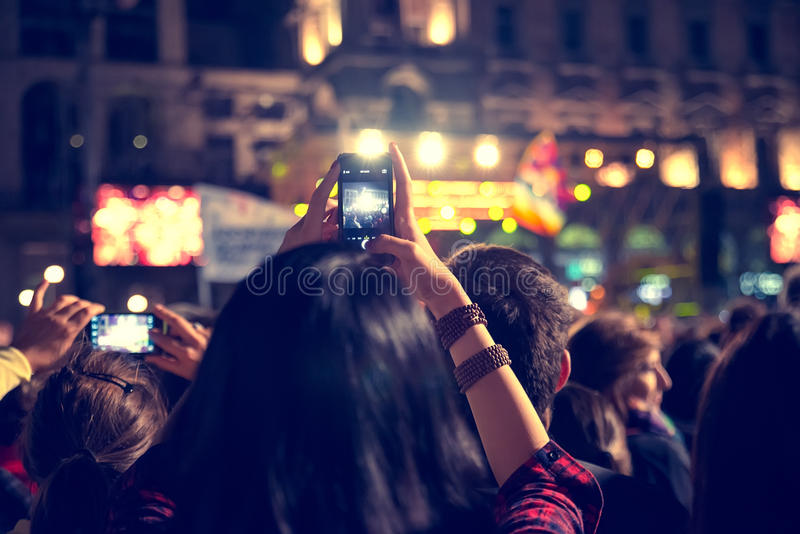 Crowd at concert. Supporters recording at concert - Candid image of crowd at rock concert stock photos