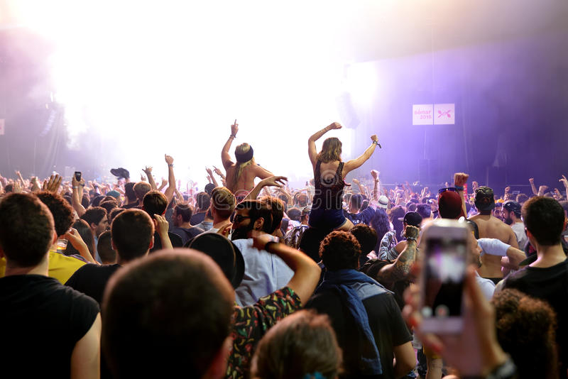 Crowd dance in a concert at Sonar Festival stock photos