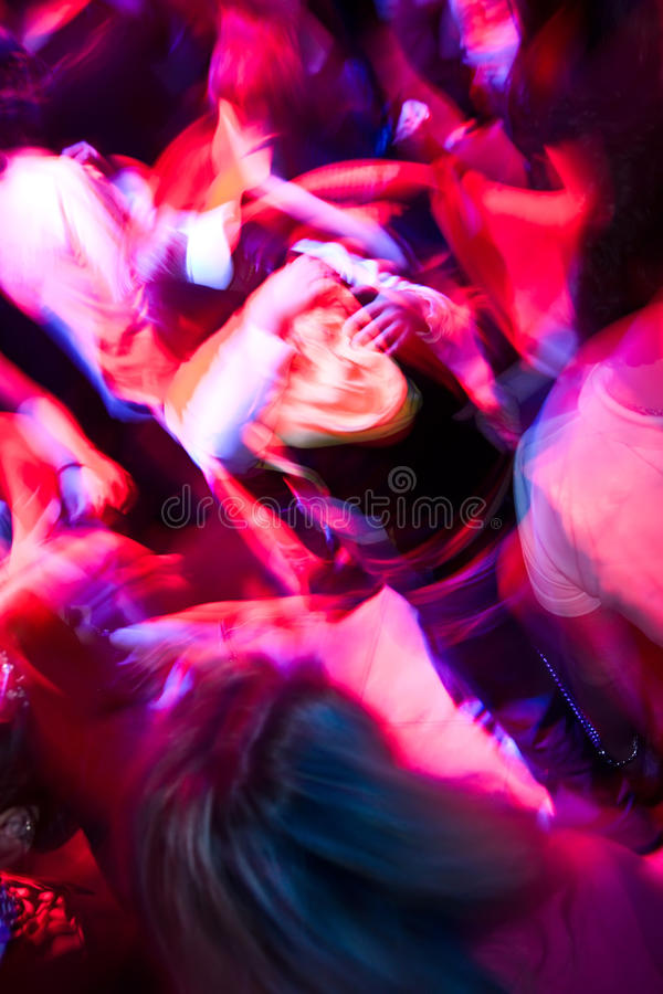 Crowd dancing in the nightclub royalty free stock photo