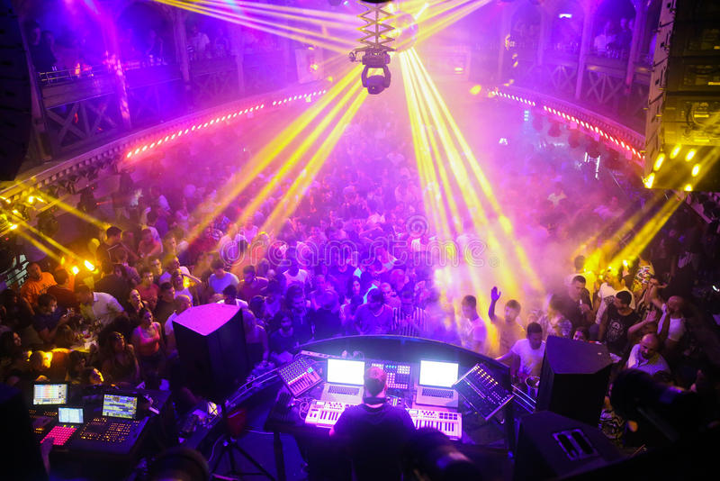 Crowd in discotheque. Yellow laser party in discotheque stock images