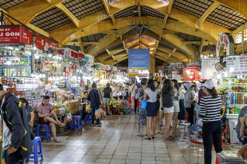 Crowd do shopping in indoor market in Saigon, Vietnam. SAIGON, VIETNAM - FEBRUARY 23, 2018: Crowd do shopping in indoor market in Saigon, Vietnam stock photography