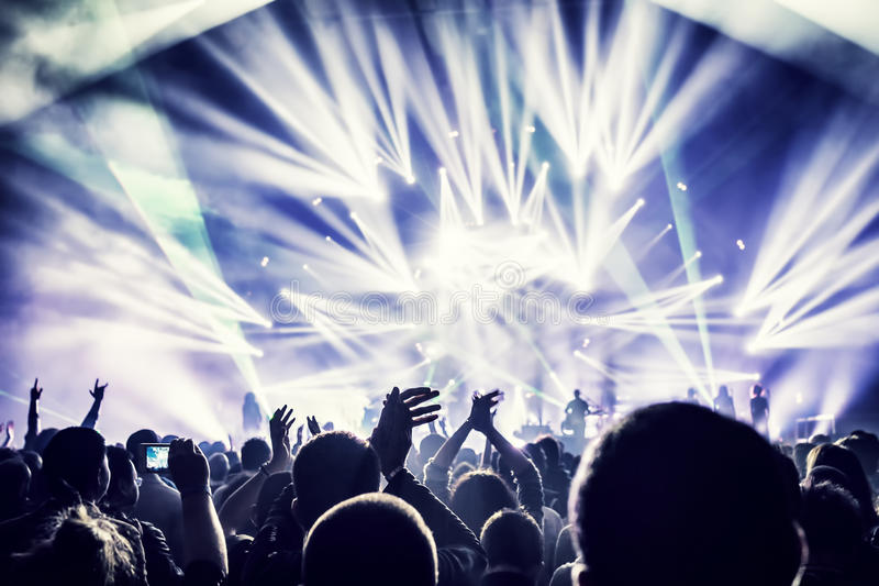 Crowd enjoying concert stock images