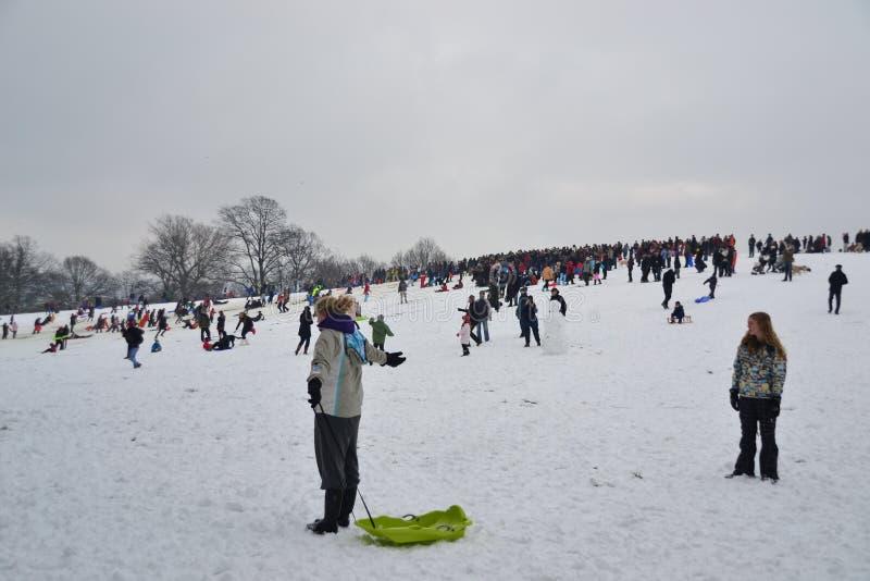 Crowd enjoying snow at Hampstead Heath, London stock photo
