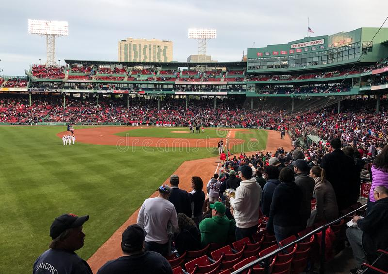 Standing for National Anthem at Fenway Park. The crowd at Fenway Park rises for the National Anthem prior to a game against the Baltimore Orioles stock images