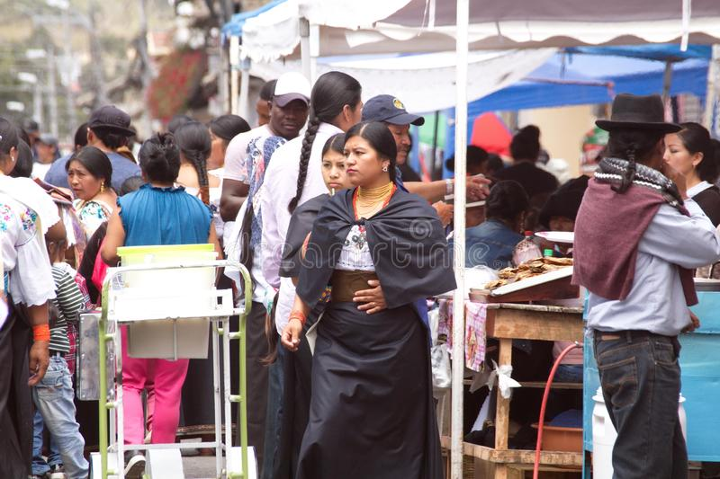 Food vendors in Cotacachi. Crowd in a food court area on Day of the Dead in Cotacachi, Ecuador stock photos