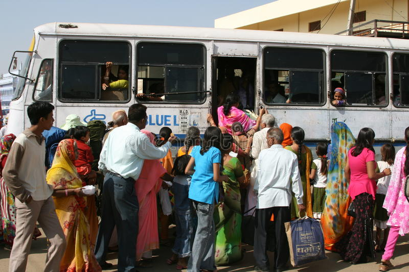 Crowd getting on bus, India royalty free stock image