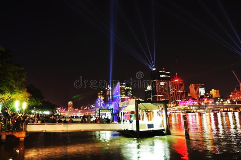 Crowd hundreds of people lined up waiting for ferry Southbank, Brisbane city, Australia royalty free stock images