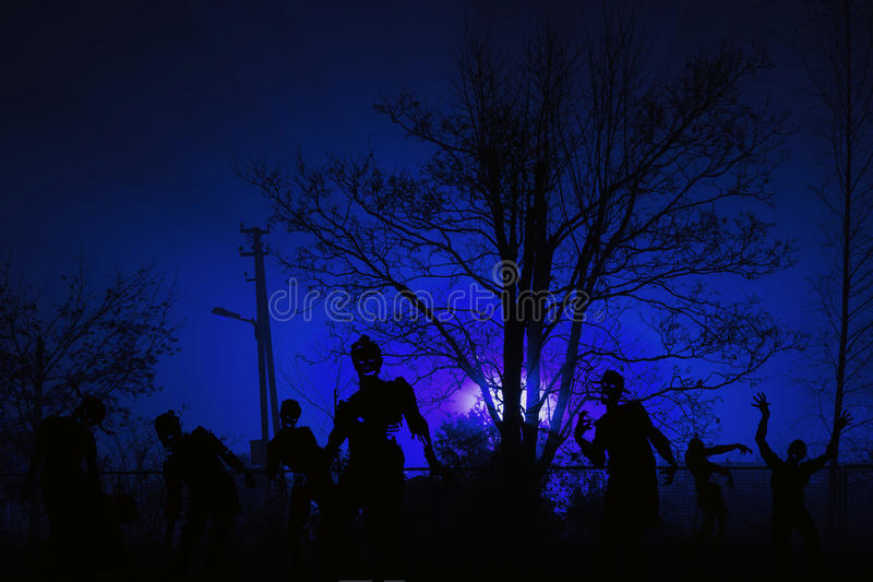 Crowd of hungry zombies near residential buildings stock image
