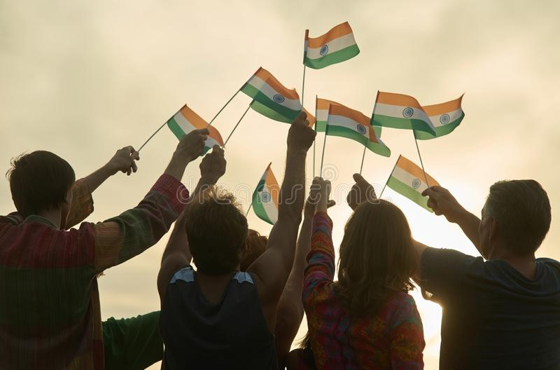 Crowd with indian flags. Silhouette of patriotic people royalty free stock photos