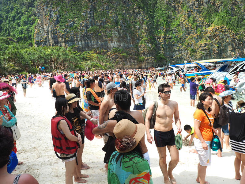Crowd on Maya Beach Thailand. MAYA BAY, THAILAND - FEBRUARY, 2015: Crowds of visitors enjoy a day trip at Maya Bay, one of the iconic beaches of Phi Phi islands stock image