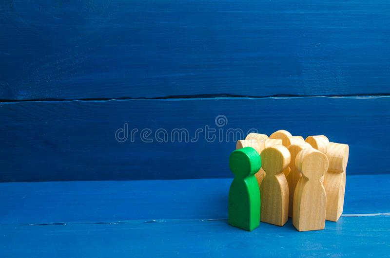 Crowd, meeting, social activity. Group people figurines. Society, social group. Herd instinct, management of people. stock photos