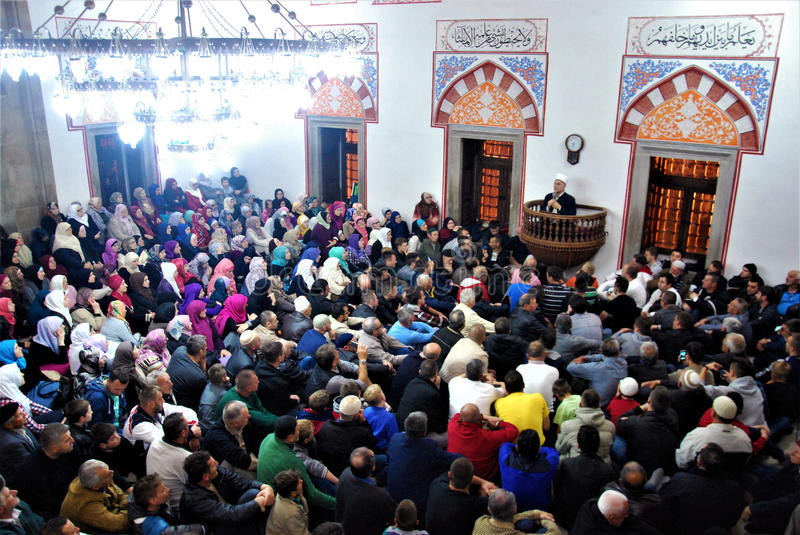 The crowd in the mosque. Lecture on spiritual love; Sufi master on top ;Maglaj, Bosnia and Herzegovina, 2016