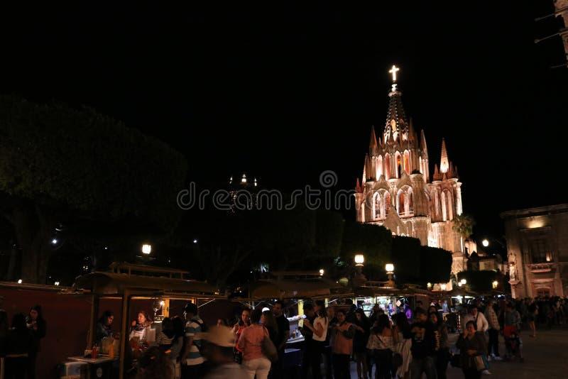 Crowd near the Parish of San Miguel Arcángel royalty free stock photo