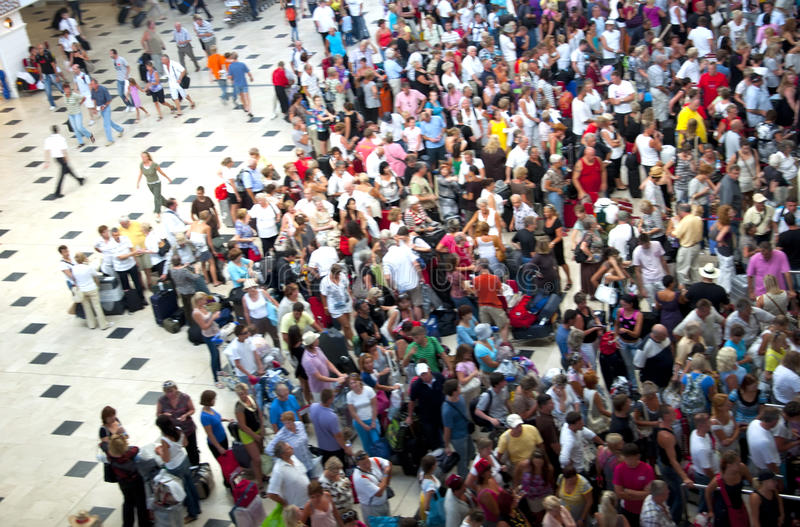 Crowd of people in the airport queue royalty free stock image