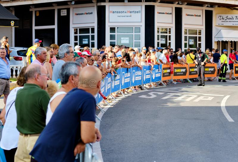 Crowd of people audience gather for watching La Vuelta race. Torrevieja, Spain - August 24, 2019: Crowd of people audience gather for watching La Vuelta popular royalty free stock photography
