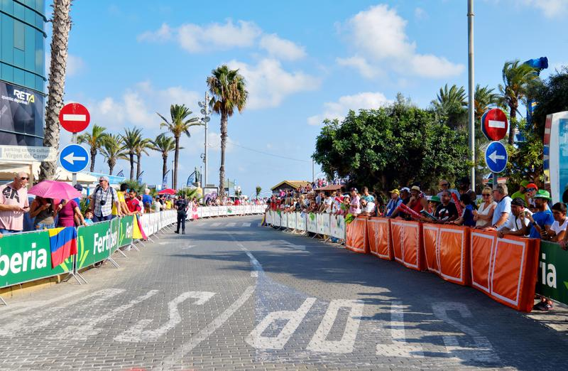 Crowd of people audience gather for watching La Vuelta race. Torrevieja, Spain - August 24, 2019: Crowd of people audience gather for watching La Vuelta popular stock photos