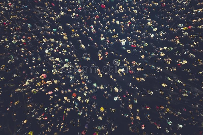 crowd people background. An aerial shot of the people gathered for an event. Crowed open-air meeting people shot from a height. A royalty free stock images