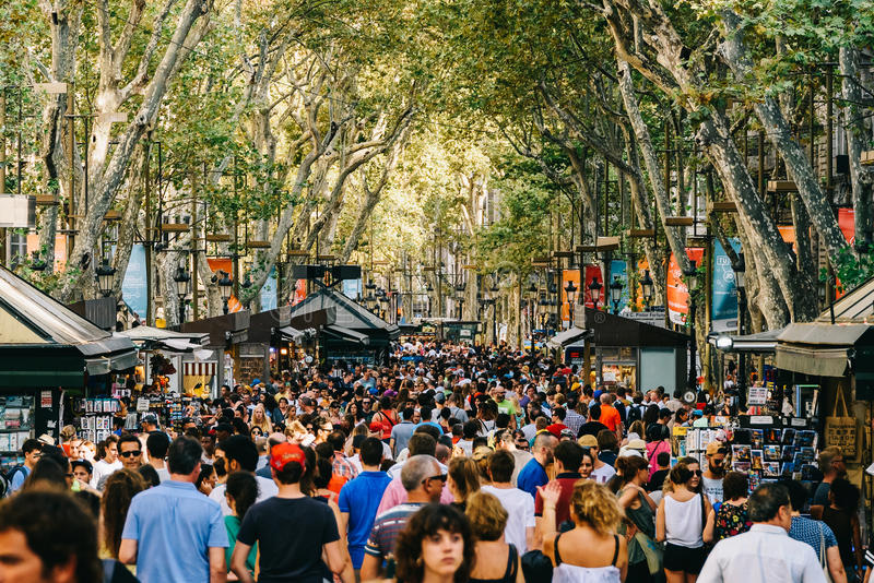 Crowd Of People In Central Barcelona City On La Rambla Street. BARCELONA, SPAIN - AUGUST 04, 2016: Crowd Of People In Central Barcelona City On La Rambla Street royalty free stock photos