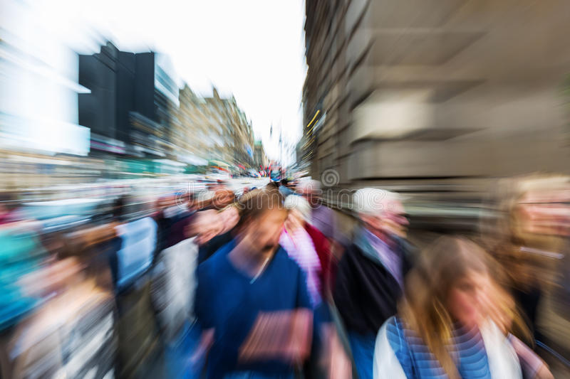 Crowd of people in the city with zoom effect stock image