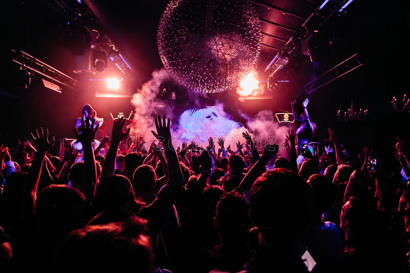 Crowd of people dancing at night club. Cheering night club crowd at concert stock photos