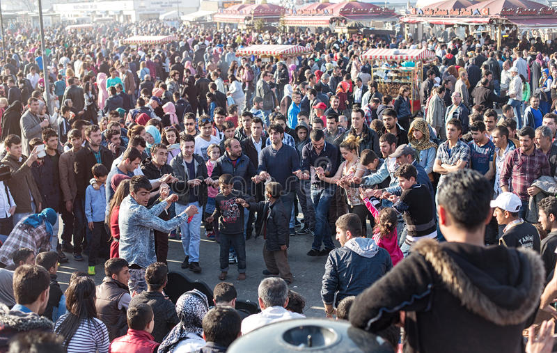 Crowd of people enjoy themselves at Eminonu Square. ISTANBUL, TURKEY - APRIL 12, 2015: Sunday afternoon in the Eminonu pier, resting and dancing people. Eminonu royalty free stock photography