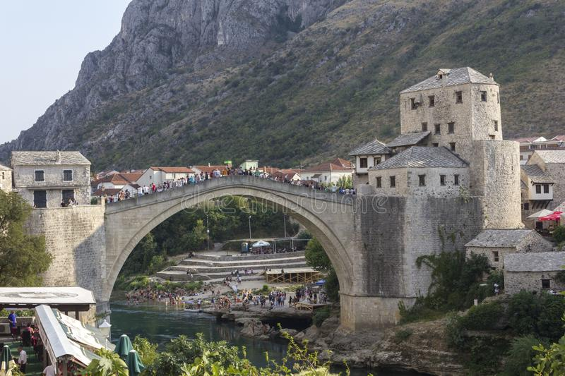 Crowd of people of the famous Mostar bridge in summer season royalty free stock image