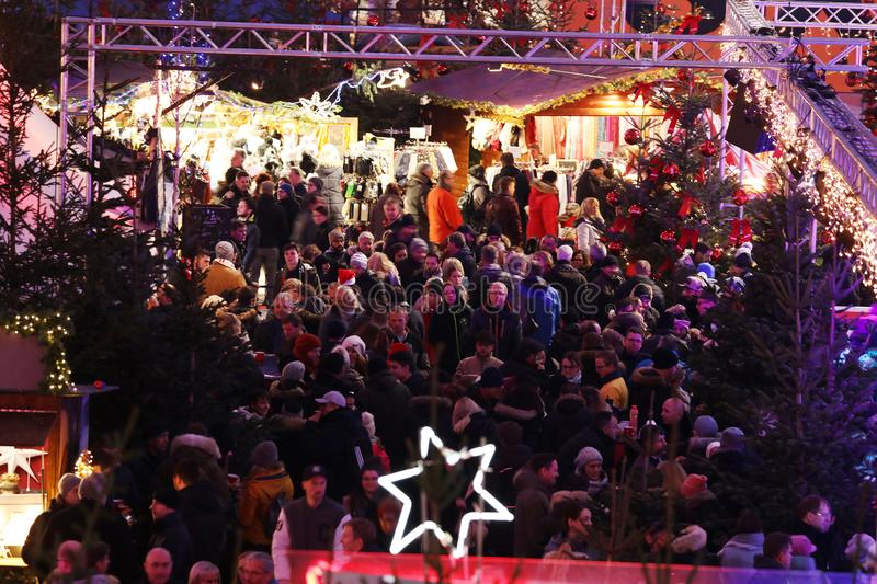 Crowd of people at food stalls in Christmas Market from Munich Airport, wide view, Germany royalty free stock photos