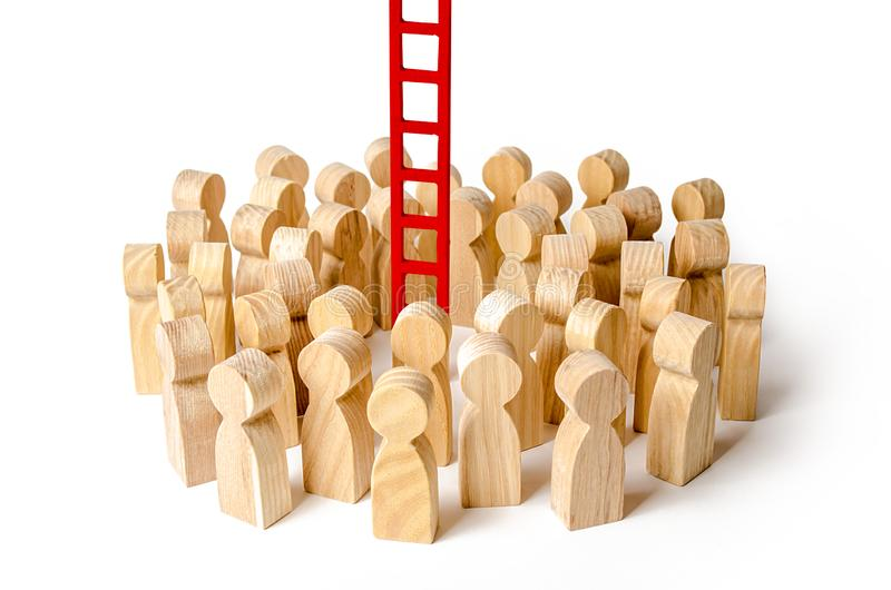 A crowd of people gathered at a red stairs. Raising and moving up the career ladder. difficult way to success. Support and help royalty free stock photo