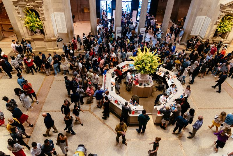Crowd of people at main hall of Metropolitan Museum of Art stock photo