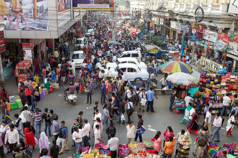 Crowd of people near the New Market, Kolkata, India. New Market is an enclosed market located in Lindsay Street. The streets around the New Market are used to royalty free stock photos