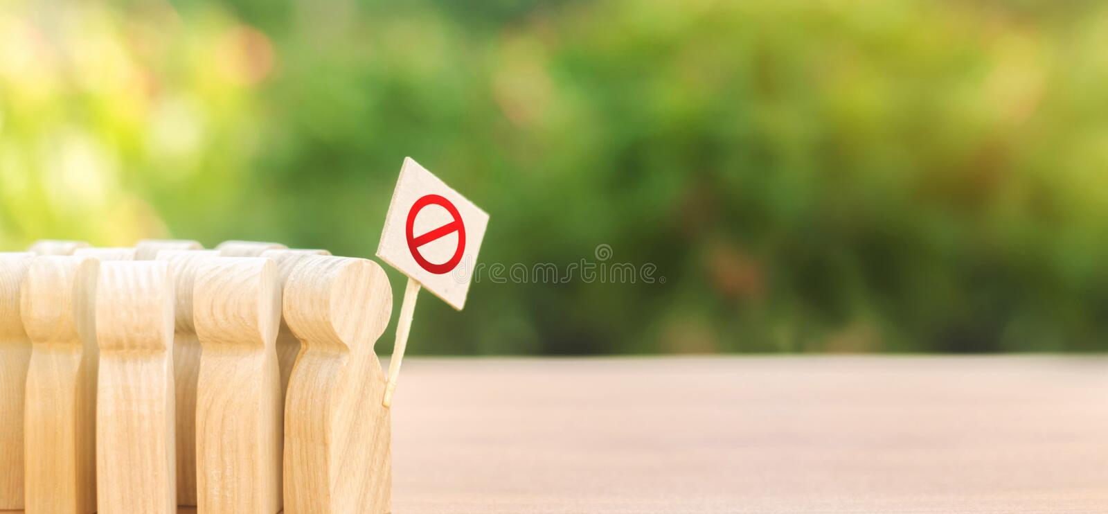 A crowd of people with posters protesting. An angry mob of wooden figures of people with a poster. Ecological movement. Social. Discontent, tension, protest and royalty free stock photo