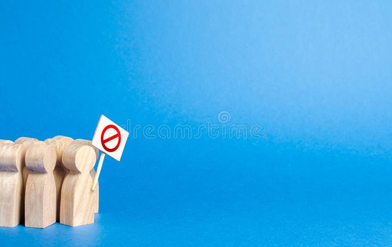 A crowd of people with posters protesting. Angry mob of wooden figures of people with a poster. Social discontent and tension,. Protest and disagreement stock image