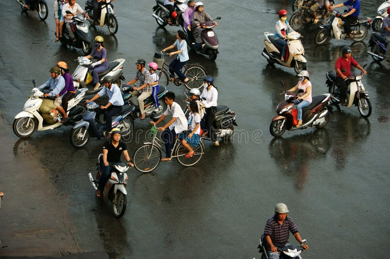 Crowd of people ride motorcycle in rush hour. HO CHI MINH, VIET NAM, ASIA- NOV 22: Crowd of people wear helmet, ride motorcycle moving on street in rush hour stock photos